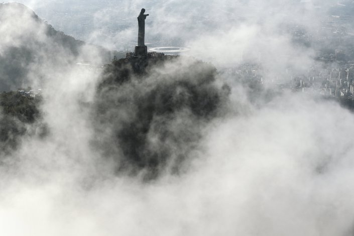RIO DE JANEIRO, BRAZIL - JULY 31: An aerial view of the Christ the Redeemer statue as Rio prepares for the 2016 Summer Olympic Games on July 31, 2016 in Rio de Janeiro, Brazil. (Photo by Patrick Smith/Getty Images)