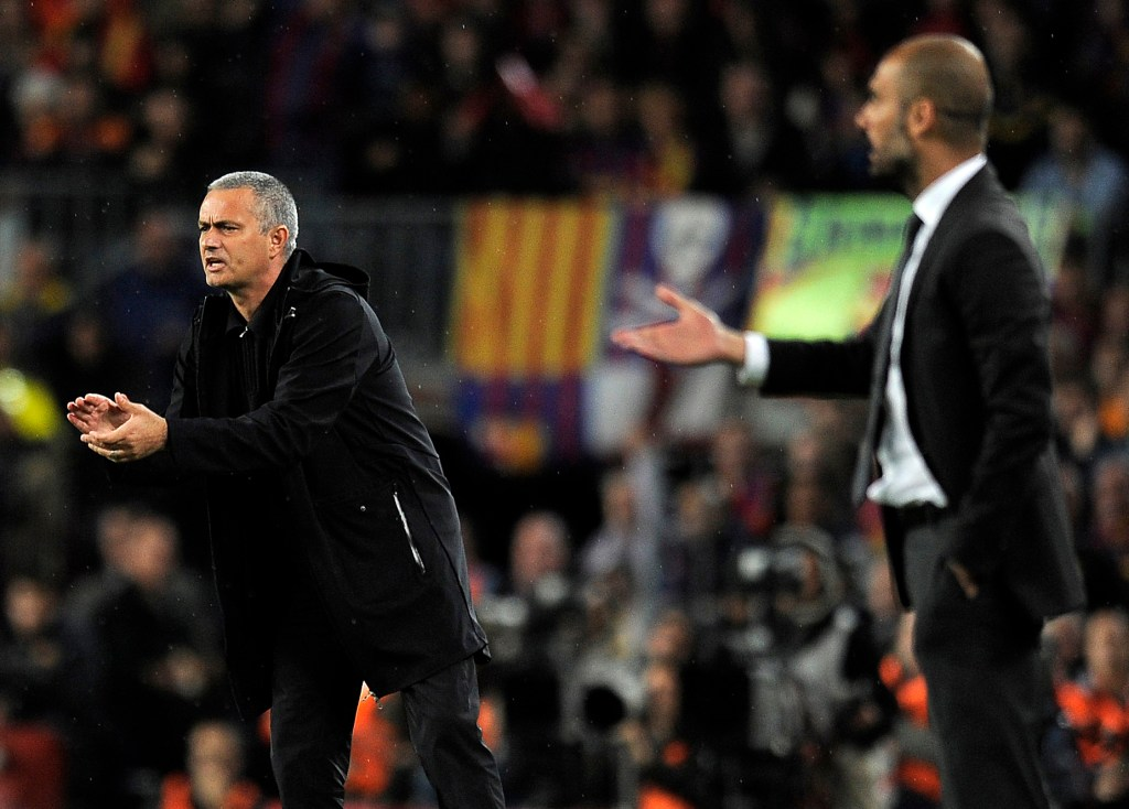 "Real Madrid's Portuguese coach Jose Mourinho (L) and Barcelona's coach Josep Guardiola react during the Spanish League ""El clasico"" football match Barcelona vs Real Madrid at the Camp Nou stadium in Barcelona on April 21, 2012. AFP PHOTO / LLUIS GENE (Photo credit should read LLUIS GENE/AFP/Getty Images)"