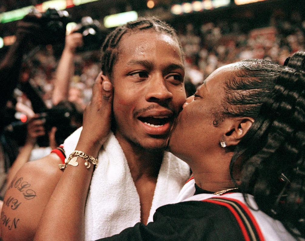 The Philadelphia 76ers' Allen Iverson gets a kiss