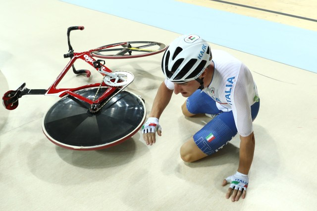 RIO DE JANEIRO, BRAZIL - AUGUST 15: Elia Viviani of Italy crashes during the Cycling Track Men's Omnium Points Race 66 on Day 10 of the Rio 2016 Olympic Games at the Rio Olympic Velodrome on August 15, 2016 in Rio de Janeiro, Brazil. (Photo by Bryn Lennon/Getty Images)