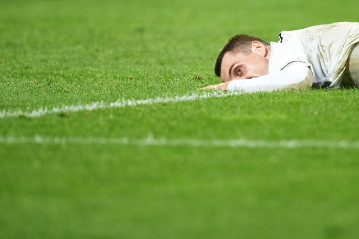WARSAW, POLAND - AUGUST 23: Michal Kucharczyk of Legia Warsaw lies and looks forward after his missing shoot during Legia Warsaw v Dundalk FC - UEFA Champions League Play Off 2nd Leg at the Wojsko Polskie Stadium on August 23, 2016 in Warsaw, Poland. (Photo by Adam Nurkiewicz/Getty Images)