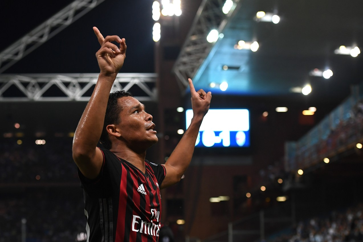 GENOA, ITALY - SEPTEMBER 16: Carlos Bacca of AC Milan celebrates after scoring the opening goal during the Serie A match between UC Sampdoria and AC Milan at Stadio Luigi Ferraris on September 16, 2016 in Genoa, Italy. (Photo by Valerio Pennicino/Getty Images)