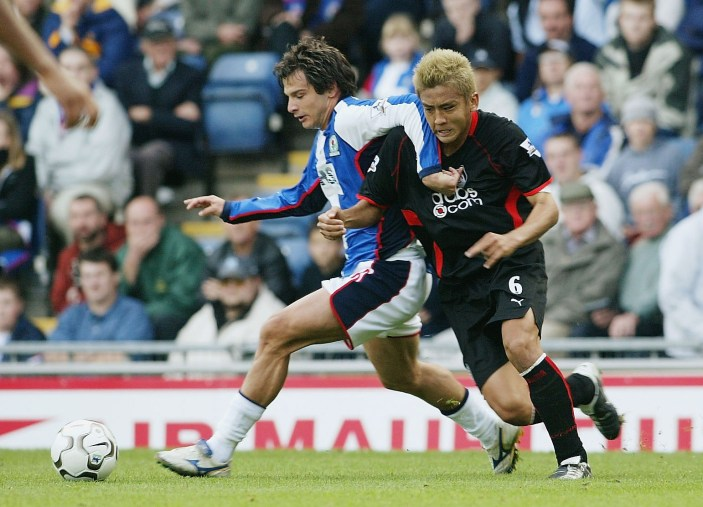 BLACKBURN, ENGLAND - SEPTEMBER 28: Junichi Inamoto of Fulham battles with Ciccio Grabbi of Blackburn during the FA Barclaycard Premiership match between Blackburn Rovers and Fulham at Ewood Park on September 28, 2003 in Blackburn, England. (Photo by Laurence Griffiths/Getty Images)