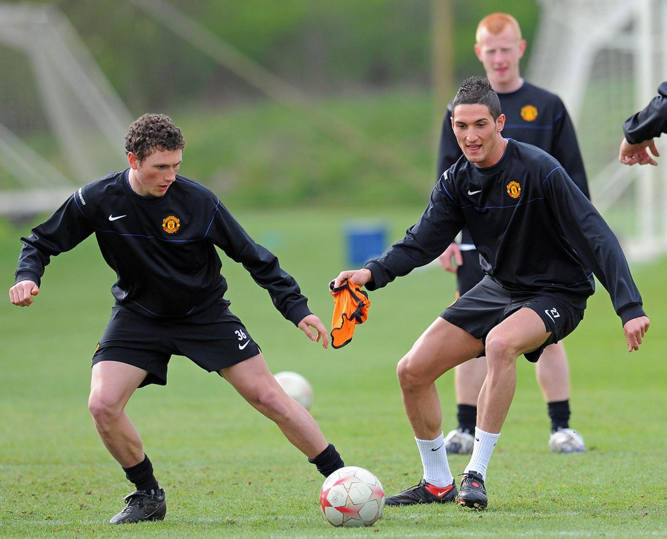 Manchester United's Italian footballer Federico Macheda (R) takes part in a training session at their Carrington training ground in Manchester, north- west England on April 6, 2009. Manchester United take on Porto in their UEFA Champions League quarter final fiest leg football match on April 7 at Old Trafford. AFP PHOTO/PAUL ELLIS (Photo credit should read PAUL ELLIS/AFP/Getty Images)