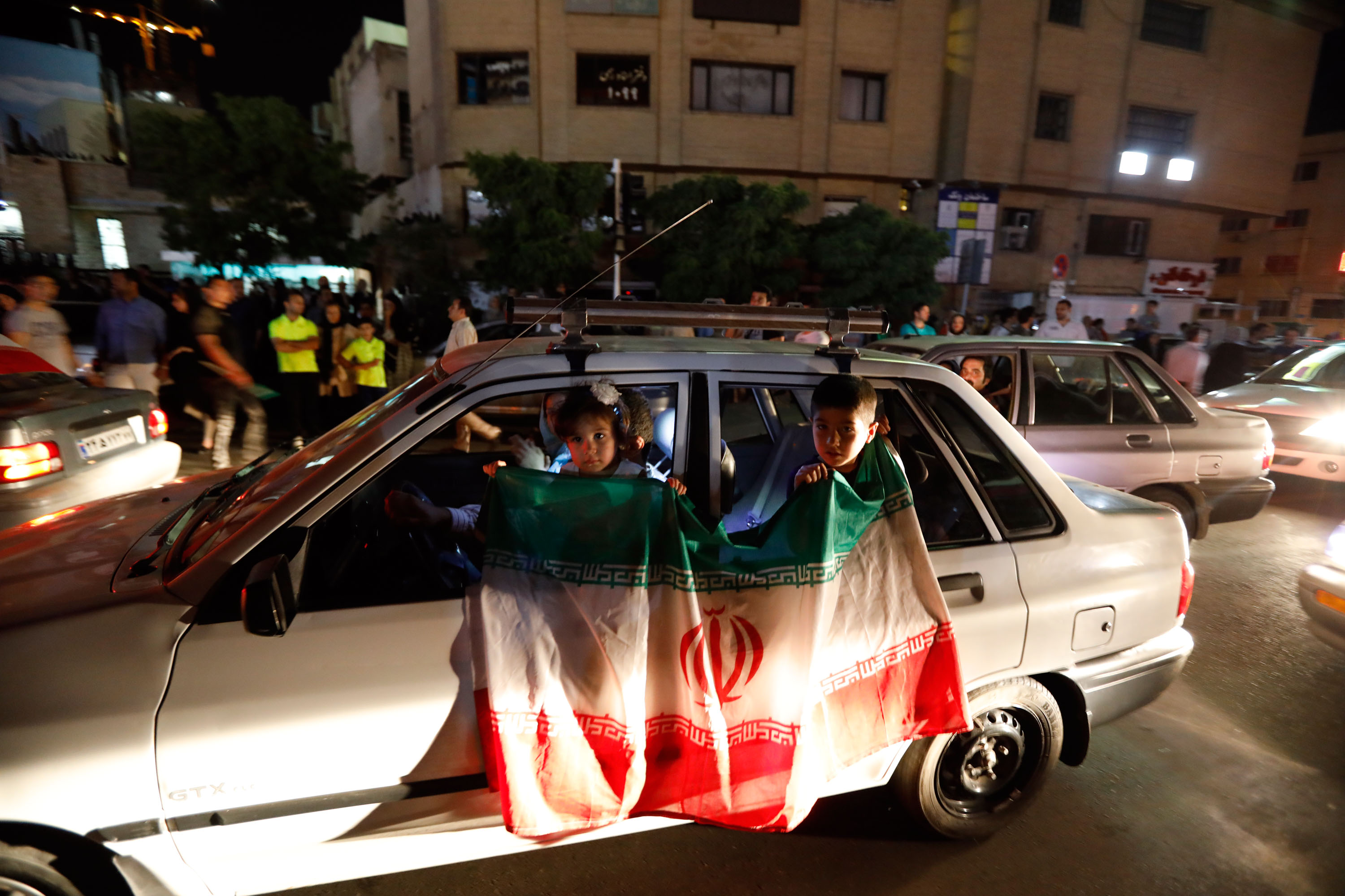 Iranians celebrate on the streets of Tehran early on June 13, 2017, after their national football team won the 2018 World Cup qualifying football match between Iran and Uzbekistan. Iran become the third team assured of a berth in the 2018 World Cup finals along with hosts Russia and Brazil after a 2-0 win over Uzbekistan in Tehran on June 12. / AFP PHOTO / STRINGER (Photo credit should read STRINGER/AFP/Getty Images)