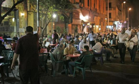 Customers of all shapes and sizes sit at street cafes in central Cairo.