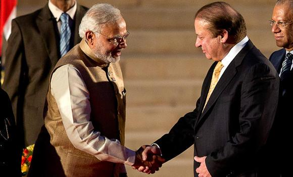 India's new Premier Narendra Modi shakes hands with his Pakistani counterpart Nawaz Sharif during Modi's inauguration in New Delhi on Monday. (AP)