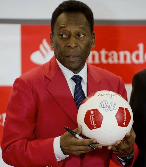 "Brazilian legend, Edson Arantes do Nascimento, aka ""Pele"", holds an autographed football during a press conference at the Universidad Anahuac in Huixquilucan, State of Mexico. Pele expressed concern on Monday that social protests in his country could prompt nervous fans from abroad to cancel their trips to the World Cup."