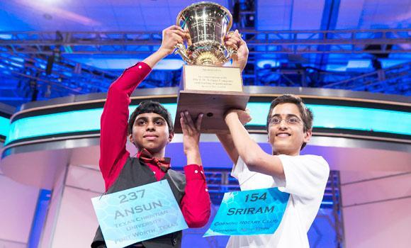Ansun Sujoe, 13, left, and Sriram Hathwar, 14, raise the championship trophy on Thursday, in Oxon Hill, Md. (AP)