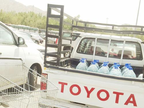 A vehicle full of Zamzam water bottles parked in front of the bottling plant in Kudai, Makkah