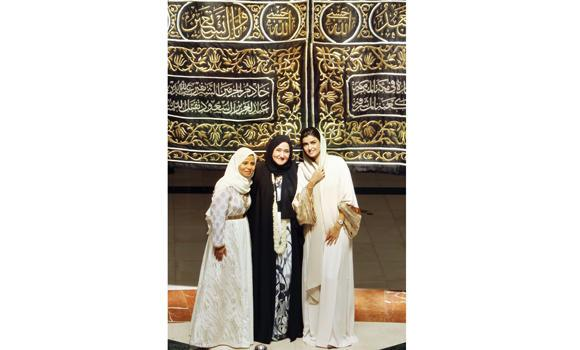 Suhair Hassan Al-Qurashi, center, in front of a Kaaba cover at Dar Al-Hekma University, Jeddah.