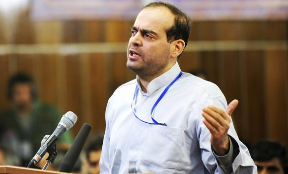 Mahafarid Amir Khosravi speaks at his trial in a court in Tehran in this Feb. 18, 2012 photo released by the Iranian Students News Agency.