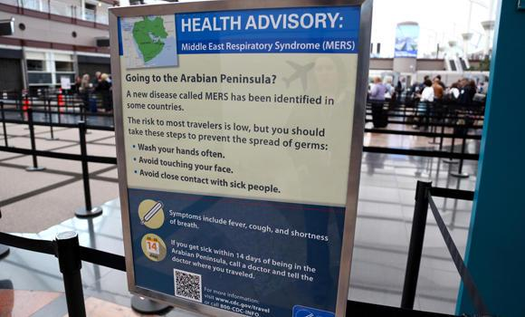 This image, provided by Denver International Airport, shows newly-erected signs warning travelers about the danger of the MERS virus. (AP)