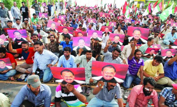 Supporters of Pakistan's MQM attend a sit-in protest condemning the arrest in London of its leader, Altaf Hussain, in Karachi, on Wednesday. (AP)