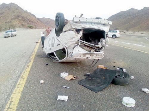 The car that overturned after a tire burst on Dhiba-Al-Wajh Road on Monday.