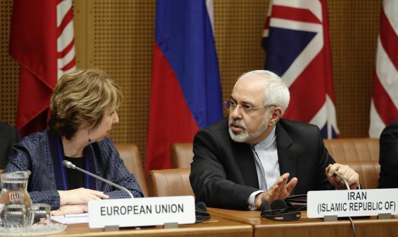 European Union Foreign Policy Chief Catherine Ashton (L) and Iranian Foreign Minister Mohammad Javad Zarif wait for the begin of talks in Vienna June 17, 2014.