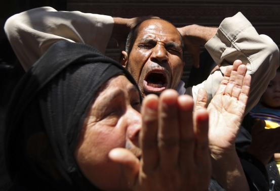 Relatives and families of members of the Muslim Brotherhood and supporters of ousted Egyptian President Mohamed Mursi react outside a court in Minya, south of Cairo, after the sentences of Muslim Brotherhood leader Mohamed Badie and his supporters were announced.