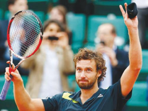 Ernests Gulbis of Latvia celebrates after beating Tomas Berdych of the Czech Republic at the French Open Tennis Tournament at the Roland Garros Stadium in Paris Tuesday.