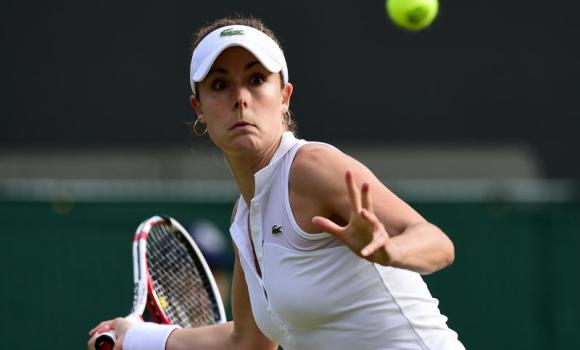 France's Alize Cornet returns to US player Serena Williams during their women's singles third round match on day six of the 2014 Wimbledon Championships at The All England Tennis Club in Wimbledon, southwest London, on Saturday. Cornet won 1-6, 6-3, 6-4 in an epic upset.