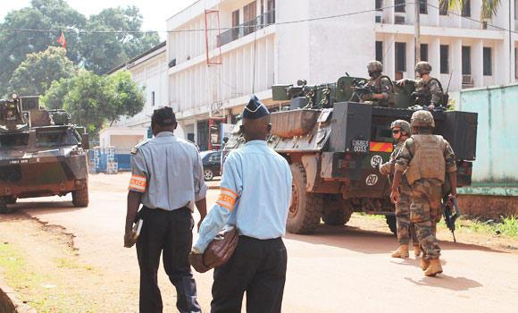 "French soldiers of the ""Sangaris Operation"" secure the perimeter around a site where World Cup football matches will be broadcast, in Bangui, Central African Republic."