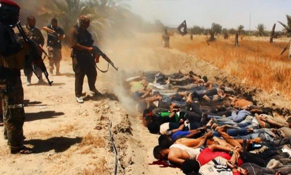An image uploaded on June 14, 2014 on the jihadist website Welayat Salahuddin allegedly shows militants of the Islamic State of Iraq and the Levant (ISIL) executing dozens of captured Iraqi security forces members at an unknown location in the Salaheddin province.