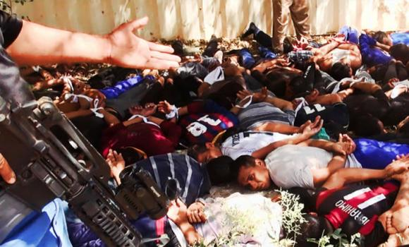 This image posted on a militant website on June 14, 2014, appears to show militants from the Al-Qaeda-inspired Islamic State of Iraq and the Levant (ISIL) with captured Iraqi soldiers wearing plain clothes after taking over a base in Tikrit, Iraq.