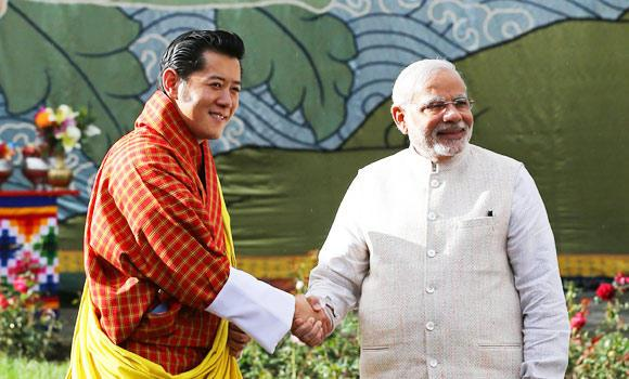 Indian Prime Minister Narendra Modi (R) shakes hands with Bhutanese King Jigme Khesar Namgyel Wangchuck in Thimphu on Sunday.