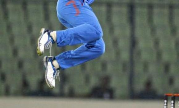 India's Stuart Binny jumps to celebrate the dismissal of Bangladesh's Mahmudullah during their second one-day International cricket match in Dhaka, Bangladesh, Tuesday.