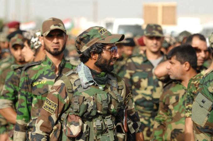 Iraqi Shia armed groups have been battling Sunni fighters who have taken control of several towns.