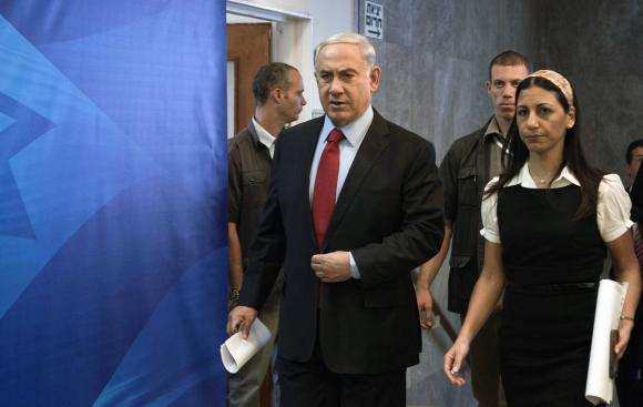 Israel's Prime Minister Benjamin Netanyahu (L) arrives at a cabinet meeting at his office in Jerusalem.