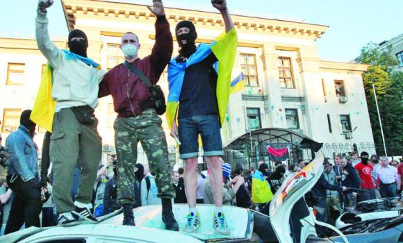 Ukrainian protesters shout slogans near the Russian Embassy during a rally in Kiev, Ukraine.