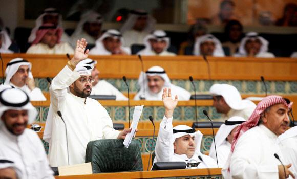 Kuwaiti MPs raise their hands during a parliament session at the national assembly in Kuwait City, in this April 3, 2013 file photo. (AFP)