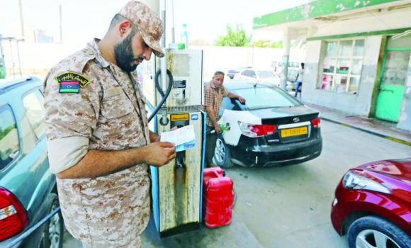 A Libyan army soldier stands guard at a petrol station in the capital Tripoli on Sunday.