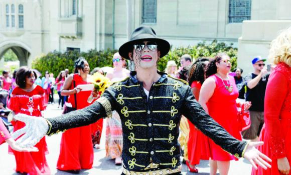 Pablo Anthony Santana, a Michael Jackson impersonator performs in front of fans gathered for the 5th anniversary of Jackson's death outside the mausoleum where Jackson is interred at Forest Lawn Memorial Park-Glendale in Glendale, California.