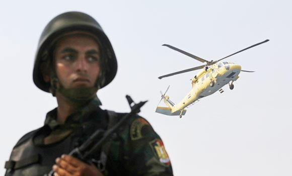 A military solider stands guard as a helicopter carrying soon to be sworn in Abdel-Fattah el-Sissi lands near the Supreme Constitutional Court, in Cairo, Egypt, in this June 8, 2014 photo.