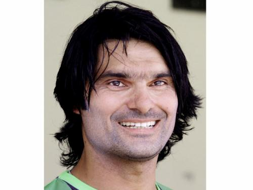 Pakistani fast bowler Mohammad Irfan listens to a reporter's question at Qaddafi Stadium in Lahore Tuesday.