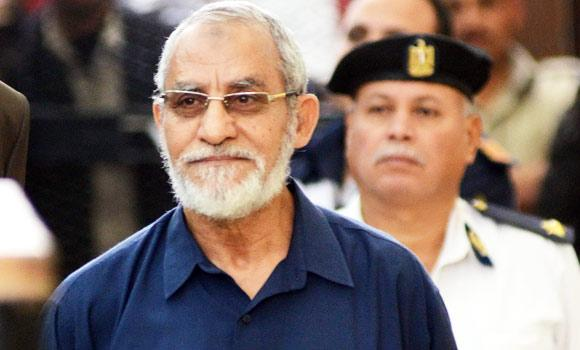Muslim Brotherhood leader Mohammed Badie walks out of a defendant cage to speak before judge during his trial in Cairo, Egypt.