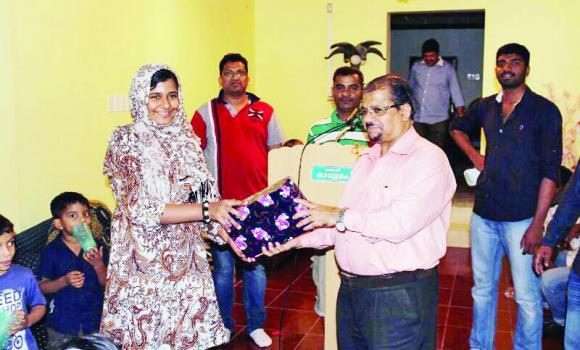P.T. Abdul Rasheed distributes prizes to winners.