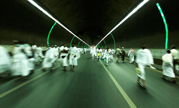 Pilgrims walk in a tunnel between the Grand Mosque in Makkah and Mina.