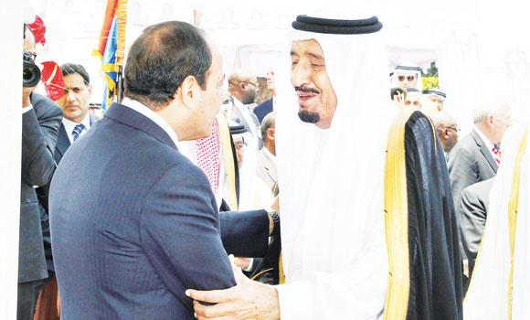 Deputy Custodian of the Two Holy Mosques Prince Salman greets Egyptian President Abdel Fattah El-Sissi during his inauguration in Cairo on Sunday.