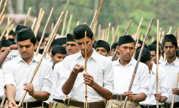 Activists from the Rashtriya Swayamsevak Sangh (RSS), a Hindu hardline group, hold bamboo sticks as they take part in a march in the central Indian city of Bhopal, in this Feb. 23, 2014 photo. (Reuters)