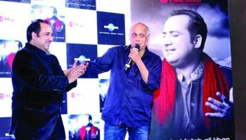 "From left, Pakistani singer Rahat Fateh Ali Khan's new album ""Back 2 Love"" was unveiled by Indian filmmaker Mahesh Bhatt in Dubai."
