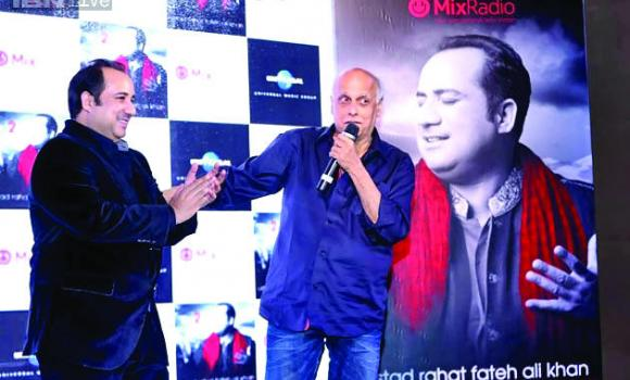 "From left, Pakistani singer Rahat Fateh Ali Khan's new album ""Back 2 Love"" was unveiled by Indian filmmaker Mahesh Bhatt in Dubai."