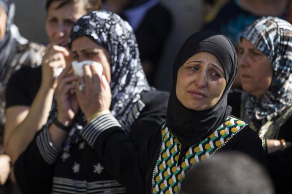 A relative mourns during the funeral of Mohammed Qaraqara in the northern town of Arabeh.