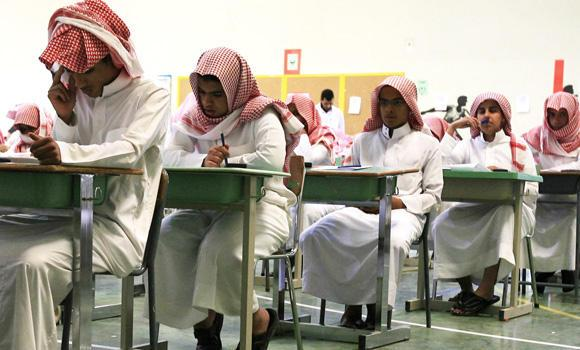 Students at a Riyadh secondary school are seen taking their exams.
