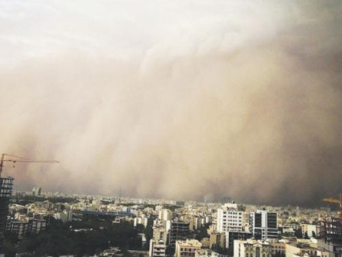 A picture taken with a smart-phone shows a sandstorm engulfing the Iranian capital Tehran on Monday. A massive sandstorm and record winds killed at least four people in Tehran, plunging the city into darkness, knocking out power supplies, damaging buildings and causing massive disruption. – AFP