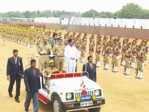 Newly-formed Telangana state's first Chief Minister K. Chandrasekhar Rao, center, reviews a guard of honor during the state's Formation Day celebrations in Secunderabad, the twin city of Hyderabad, on Monday. — AFP