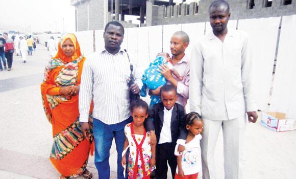 The visiting pilgrim family from Sudan.