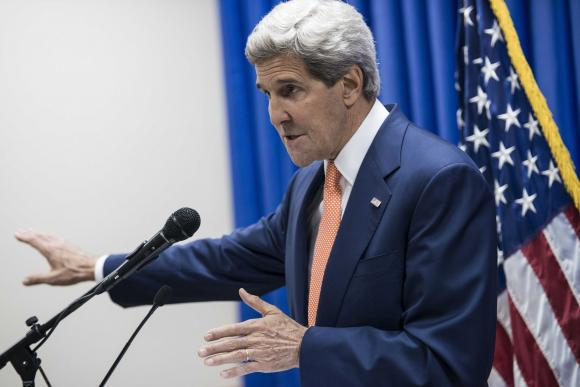 U.S. Secretary of State John Kerry speaks during a news conference at the U.S. embassy in the International Zone in Baghdad