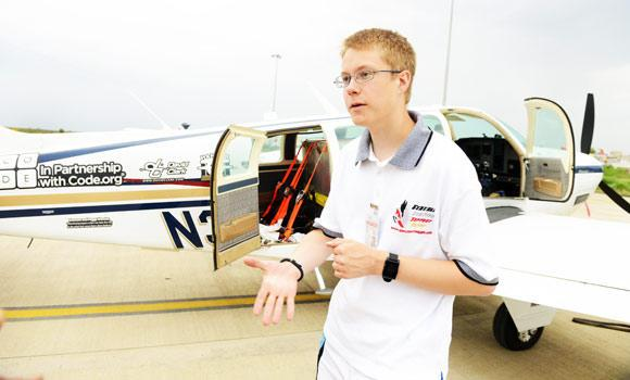 US pilot Matt Guthmiller (19), gestures as he speaks outside his single-engined Beechcraft A36 Bonanza aircraft at the Dr Babasaheb Ambedkar International Airport in Nagpur on Thursday.